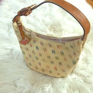 Dooney & Bourke Coated cream canvas small handbag